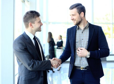 Photo for Businesss and office concept - two businessmen shaking hands in office - Royalty Free Image