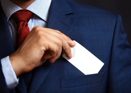 Businessman putting card