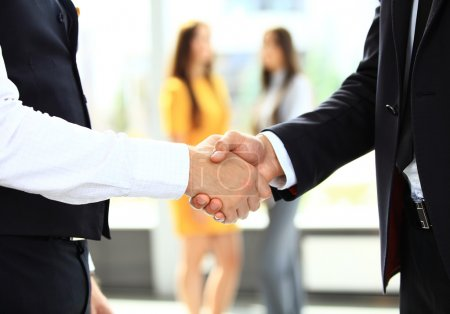 Photo for Business and office concept, two businessmen shaking hands in office - Royalty Free Image