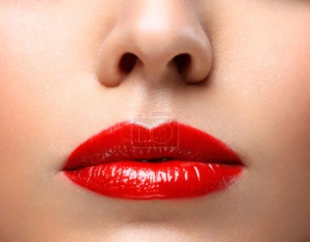 Photo for Red Sexy Lips and Nails closeup. Open Mouth. Manicure and Makeup. Make up concept. Half of Beauty model girls face isolated on black - Royalty Free Image