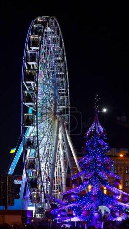 kiev ukraine ferris wheel and christmas tree.