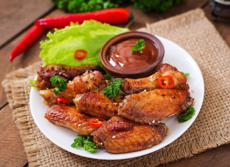 baked chicken wings and sauce