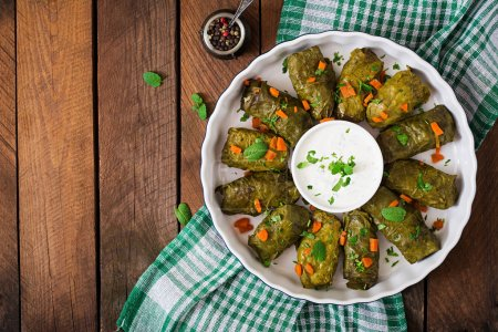 Photo for Dolma stuffed with rice and meat - greek traditional appetizer. Top view - Royalty Free Image
