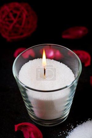 Burning candle on background
