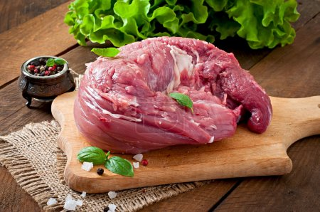 Photo for Raw pork tenderloin on wooden cutting board - Royalty Free Image