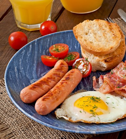 Photo for English breakfast - toast, egg, bacon and vegetables in a rustic style on wooden background - Royalty Free Image