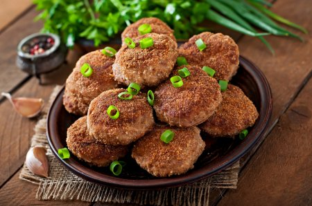 Juicy delicious meat cutlets with vegetables  on a...