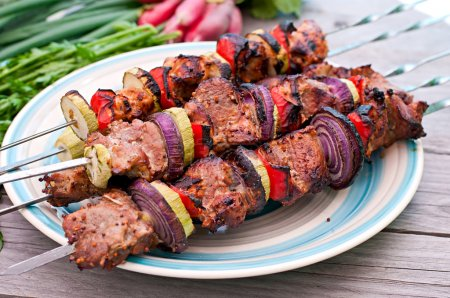 Photo for Juicy kebabs and grilled vegetables on plate - Royalty Free Image