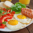 Homemade english breakfast - fried eggs, sausages,...