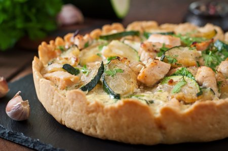 Quiche with chicken and zucchini with herbs