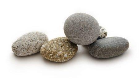 Photo pour Ensemble de pierres de mer sur fond blanc - image libre de droit