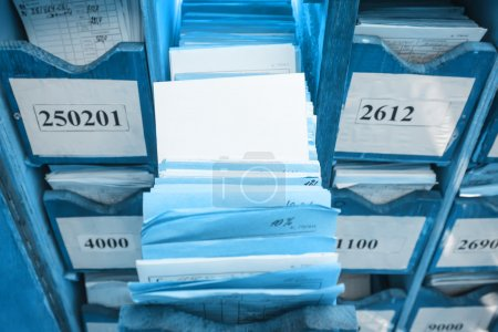 Photo for Paper documents stacked in archive on shelf - Royalty Free Image