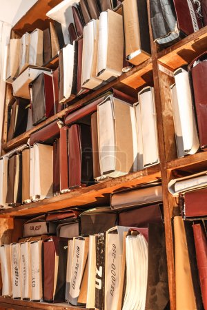 Photo for Paper documents stacked in archive on shelves - Royalty Free Image
