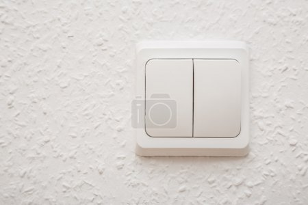 Power switch on white wall