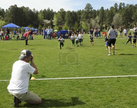 A Photographer Shoots a Flag Football Game