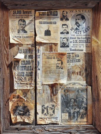 A Wooden Frame Full of Wanted Posters