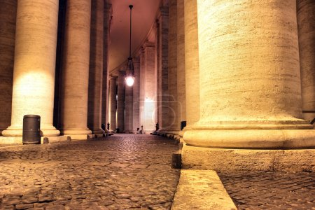 Saint Peter's colonnade at night