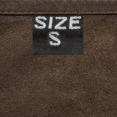 Hnědá kůže textury closeup, značka, velikost