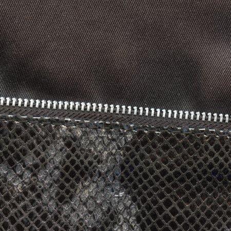 dark artificial snake skin texture closeup, zipper