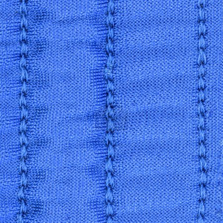 blue textile texture decorated with seams