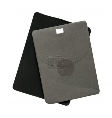 black tag and gray  paper envelope for spare button