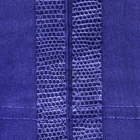 blue textile texture decorated with leather inserts