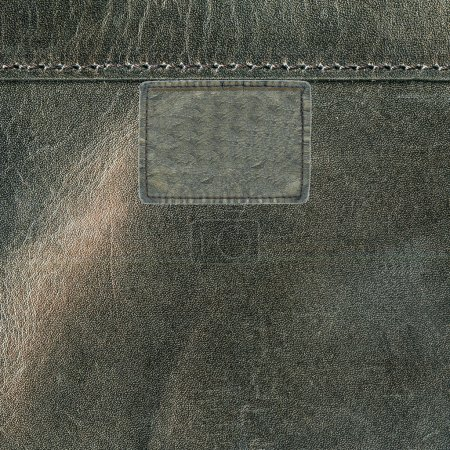 gray leather label on leather background. Textures