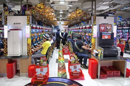 Two rows of japanese slot machines in the unidentified Pachinko parlor Tokyo, Japan