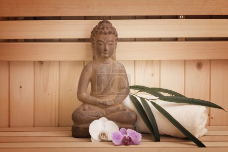 ayurveda symbols for relaxation and inner beauty,buddha statue in sauna