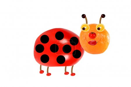 Creative food concept. Funny little  ladybird made from fruit an