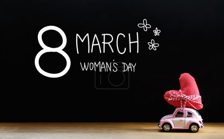 Womans Day message with miniature pink car