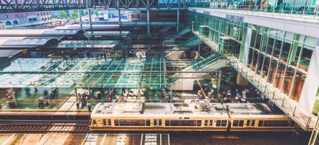 Commuters boarding trains inside the massive Osaka Station