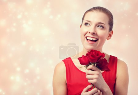 Woman holding red roses