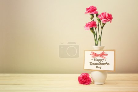 Happy Teachers Day message with carnations