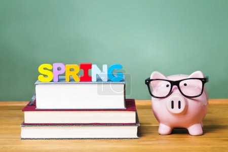 Spring Semester theme with textbooks and piggy ban...