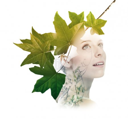 Double exposure of woman with tree leaves