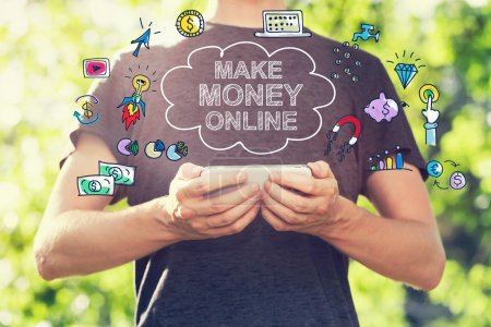 Make Money Online concept with man holding his smartphone