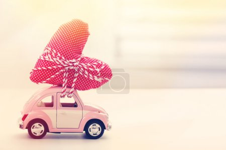Photo for Miniature car carrying a red heart cushion - Royalty Free Image