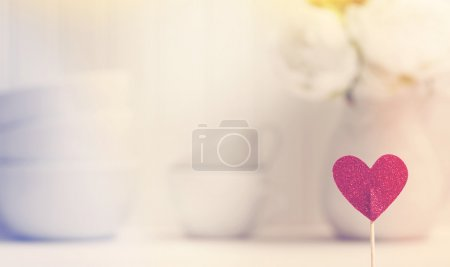 Photo for Small red heart with white porcelain dishes and flowers - Royalty Free Image
