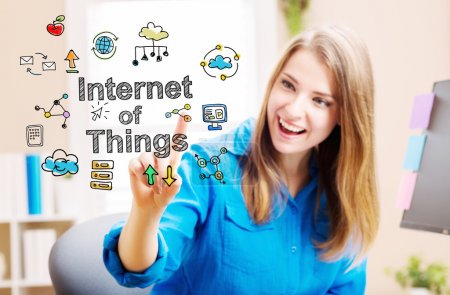 Photo for Internet of Things concept with young woman in her home office - Royalty Free Image