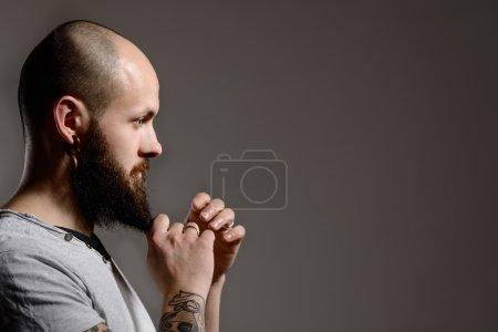 Side view portrait of  bearded man
