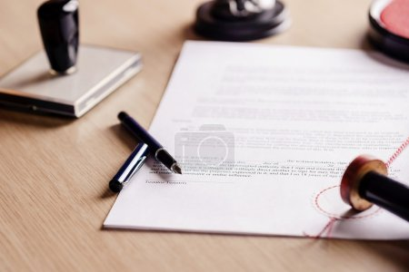 Notary pen lying on testament. Notary public worki...