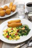jamaican breakfast,ackee and saltfish with fried dumplings and callaloo