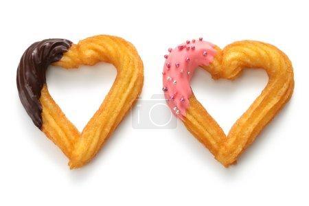 Photo pour Churro en forme de coeur fait maison, dessert de la Saint Valentin - image libre de droit