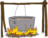 Isolated pot of food boiling in isolated campfire