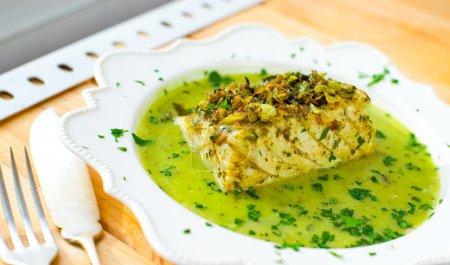 Codfish in green sauce.