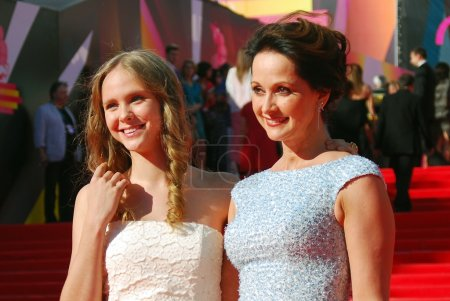 Actress Olga Kabo (in blue dress) with her daughte...