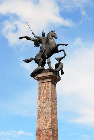 Sculpture of St. George on horseback, striking snake