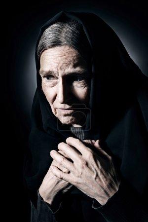 Sad old woman senior in sorrow