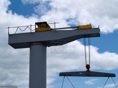 Boat lifter crane in a marina ready for work horiz...
